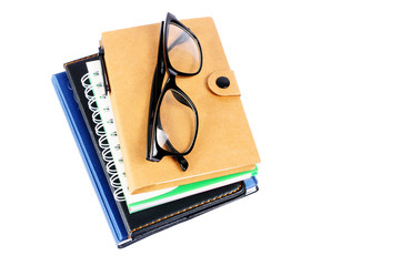 Stack of Books with eyeglasses