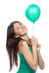 Woman hold green balloon in hands for birthday party