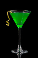 Green cocktail with absinth in martini glass for halloween night