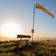 Windsock and bench to watch paragliders