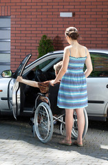Disabled female driver and caregiver
