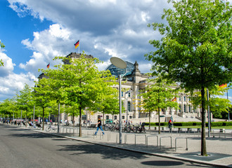 BERLIN - MAY 27, 2012: Tourists walk along Reichstag area. More