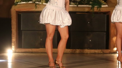 beautiful actress girl in white clothes dancing on the stage