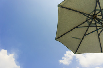 Open umbrella with nice blue sky background