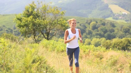 Athletic woman running in countryside