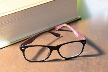 Glasses and a big book