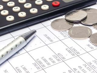 Calculator, coin and pen