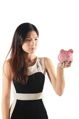 Businesswoman Holding Piggy Bank as Savings Concept