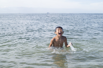 Children playing and diving in the ocean