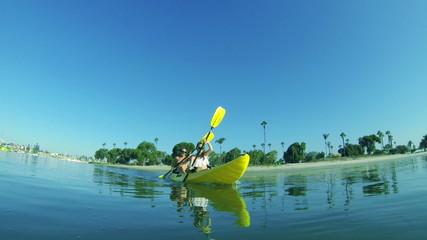 Couple Kayaking Outside At Beach Lifestyle