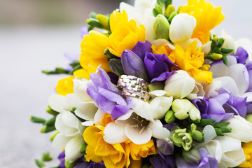 Wedding bridal bouquet and wedding rings