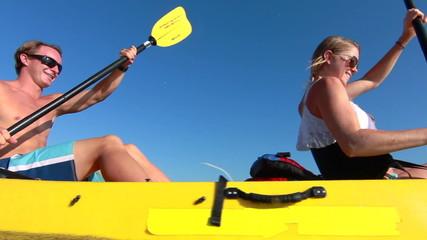 Couple Kayaking Outside In Ocean