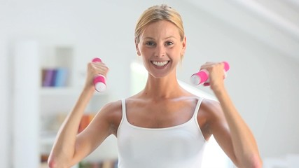 Fitness girl exercising with dumbbells