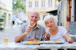 Senior couple relaxing in outdoors cafe