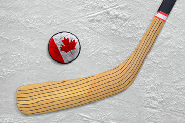 Hockey stick and puck on the Canadian hockey rink