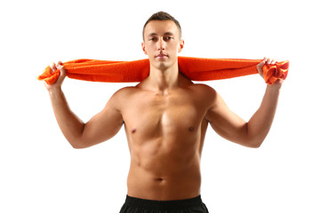 Handsome young muscular sportsman holding towel isolated