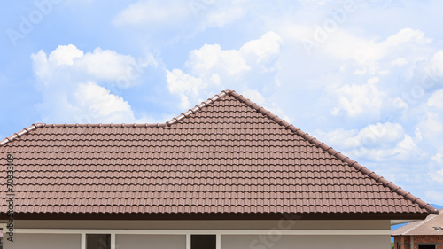 Staande foto Industrial geb. roof under construction with stacks of roof tiles for home build