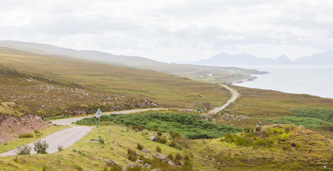 Highlands of Scotland narrow road in mountain landscape