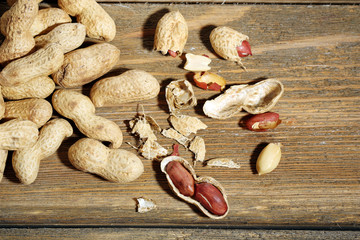 Peanuts on wooden background