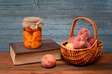 Fresh peaches in wicker baskets and books