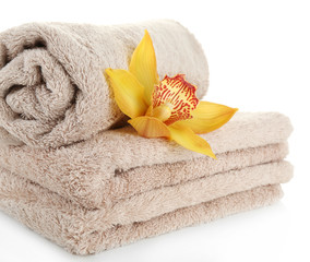 Orchid flower and towels isolated on white