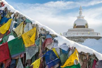 Shanti stupa with prayer flag foreground