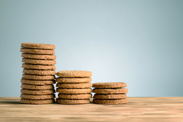 Stack of chocolate chips cookies on wooden table