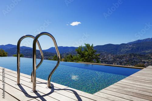 Grab bars ladder in the swimming pool - 70337914