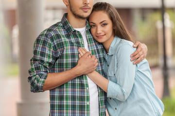 Smiling young girl huging man.
