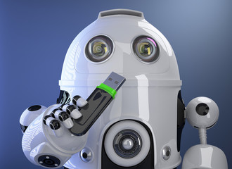 Robot holding USB memory stick. Contains clipping path