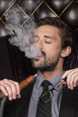 man smoking shisha at arabic restaurant.