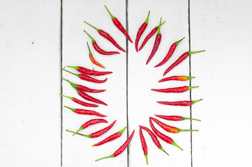 Red hot pepper on wooden background