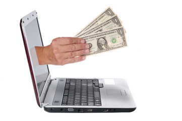 Hand with dollar banknotes comes from the laptop screen