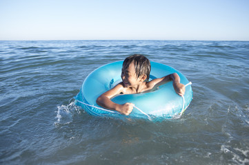 Boy playing in the float