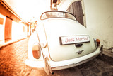 Fototapety Antique wedding car with just married sign