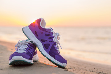 Pair of sports shoes on the beach