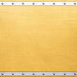canvas print picture - Golden metal plate with rivets