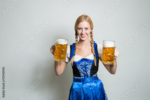 canvas print picture young blonde german woman in a dirndl dress