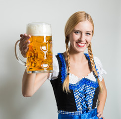 young blonde german woman in a dirndl dress