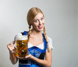 canvas print picture - young blonde german woman in a dirndl dress