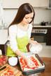 Girl in  kitchen preparing cake