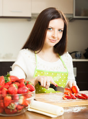 woman preparing strawberry cake