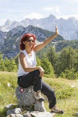Cute middle aged female hiker  waving hello