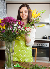girl with flowers on  kitchen table