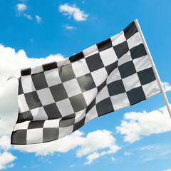 Checkered flag with white clouds on background - 1 to 1 ratio
