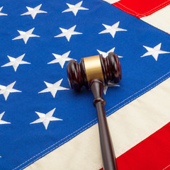 Wooden judge gavel over USA flag - closeup shoot - 1 to 1 ratio