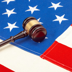 Wooden judge gavel over US flag - 1 to 1 ratio