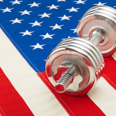 Dumbbell over US flag - 1 to 1 ratio