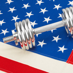 Metal dumbbell over US flag - 1 to 1 ratio