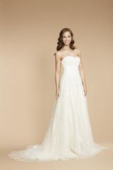 Elegant young bride in wedding dress, studio shot.